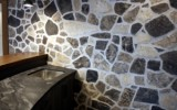 bar wall with natural stone counter