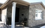 We went from full bed faux stone to a thin veneer transition on the porch and around the side of the house
